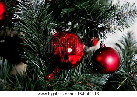 Closeup of Christmas-tree decorations. REd color of balls