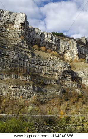 Magnificent Lakatnik rocks in full height and road, Iskar river defile, Sofia province, Bulgaria