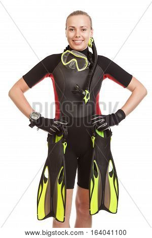 Young smiling blonde woman wearing a wet suit to swim with mask. Studio shot.