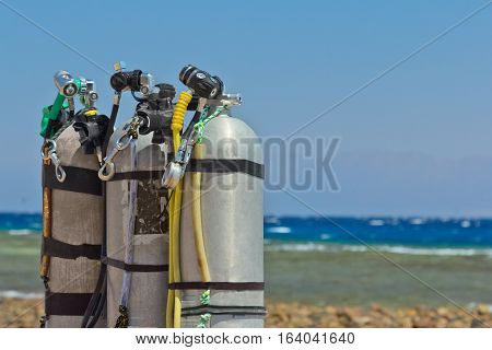 Scuba equipment with jxygen air tank on the beach.