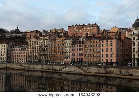 Lyon, France - December 20, 2016: houses on Embankment St. Vincent. River Saone (Sona) in December 20 in Lyon, France