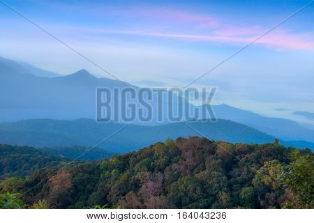 Landscape view of mountains and mist at sunrise time at Doi Inthanon National Park High mountain in Chiang Mai Province Thailand