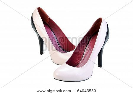 women shoes isolated over white. Apricot color high heels shoes