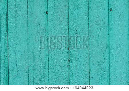 Cracked weathered green and blue painted wooden board texture