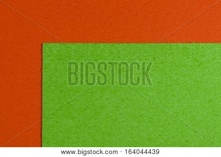Eva foam ethylene vinyl acetate apple green surface on orange sponge plush background