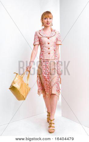 beautiful young woman bears a bag