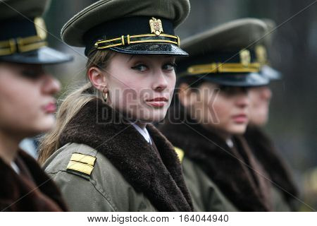 BUCHAREST ROMANIA - DECEMBER 1 2010: Military women are taking part to a military parade on National Day of Romania. More than 3000 soldiers and personnel from security agencies take part in the massive parades on National Day of Romania.