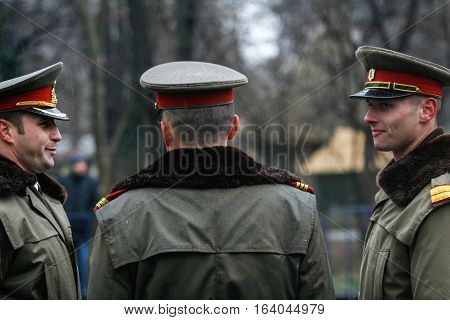 BUCHAREST ROMANIA - DECEMBER 1 2010: Military are chatting during a military parade on National Day of Romania. More than 3000 soldiers and personnel from security agencies take part in the massive parades on National Day of Romania.