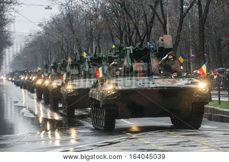 BUCHAREST ROMANIA - DECEMBER 1 2010: Military on heavy vehicles are taking part to a military parade on National Day of Romania. More than 3000 soldiers and personnel from security agencies take part in the massive parades on National Day of Romania.