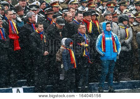 BUCHAREST ROMANIA - DECEMBER 1 2014: Officials are taking part to a military parade on National Day of Romania. More than 3000 soldiers and personnel from security agencies take part in the massive parades on National Day of Romania.