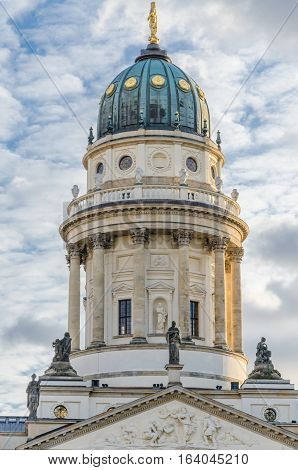 View on German Cathedral at Gendarmenmarkt square on a crips winter day with soft clouds, Berlin, Germany.