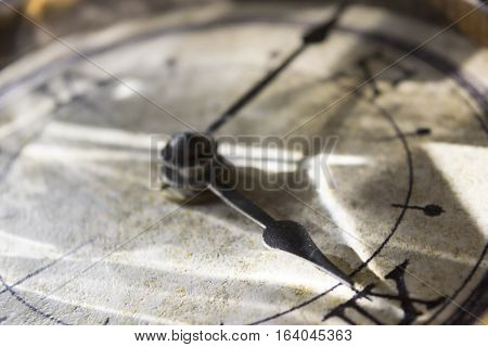 hands on an old clock with roman numbers