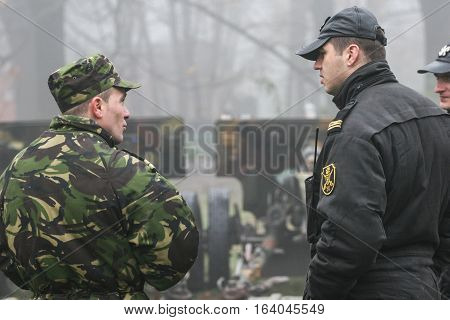 BUCHAREST ROMANIA - DECEMBER 1 2008: Soldiers are chatting during a military parade in Bucharest. More than 3000 soldiers and personnel from security agencies take part in the massive parades on National Day of Romania.