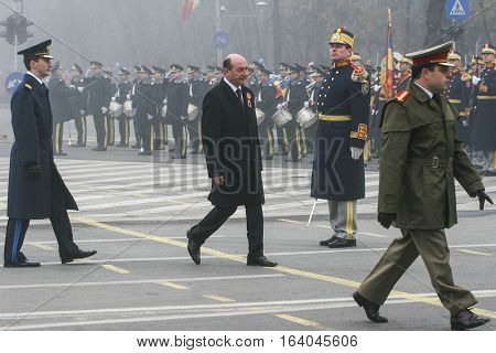 BUCHAREST ROMANIA - DECEMBER 1 2008: Romanian president Traian Basescu is taking part to a military parade on National Day of Romania. More than 3000 soldiers and personnel from security agencies take part in the massive parades on National Day of Romania