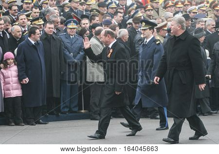 BUCHAREST ROMANIA - DECEMBER 1 2008: Romanian president Traian Basescu salutes the officials during a military parade on National Day of Romania. More than 3000 soldiers and personnel from security agencies take part in the massive parades on National Day