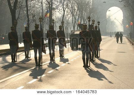 BUCHAREST ROMANIA - DECEMBER 1 2011: Military are marching during a military parade in Bucharest. More than 3000 soldiers and personnel from security agencies take part in the massive parades on National Day of Romania.