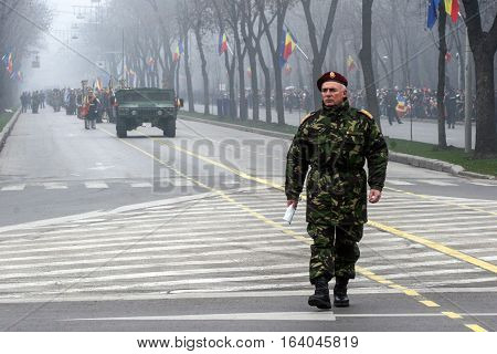 BUCHAREST ROMANIA - DECEMBER 1 2009: A military is taking part to a military parade on National Day of Romania. More than 3000 soldiers and personnel from security agencies take part in the massive parades on National Day of Romania.