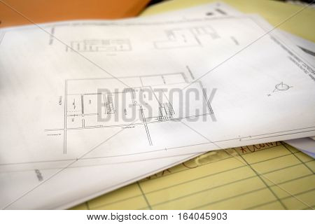 work table of an engeneer with plans and projects