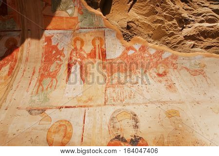 KAKHETI, GEORGIA - OCT 8, 2016: Saint people and ngels on ancient fresco of the 6th century David Gareja cave monastery on October 8, 2016. Complex located on border between Georgia and Azerbaijan