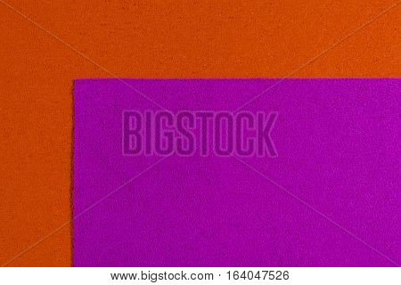 Eva foam ethylene vinyl acetate pink surface on orange sponge plush background