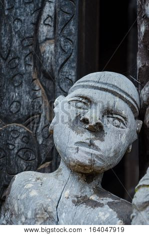 Detail of wood carving of male human at traditional Fon's palace in Bafut, Cameroon, Africa.