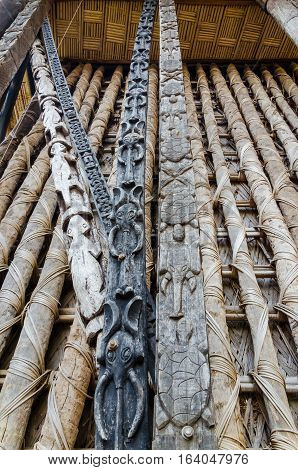 Detail of animal wood carvings on pillars at traditional Fon's palace in Bafut, Cameroon, Africa.