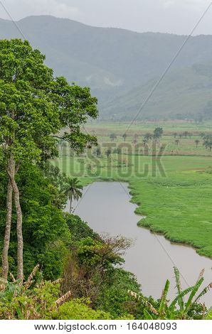 River with mountains and lush vegetation at Ring Road in Cameroon, Africa.