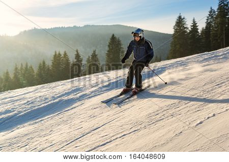 Young man skiing on the of winter resort