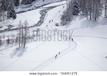 Some people practice Nordic skiing in Valnontey, Aosta Valley, Italy