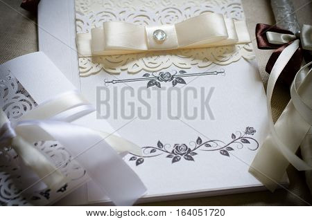 White wedding card with ribbons and ornaments space for text