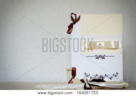 White wedding card with ribbons and place for text