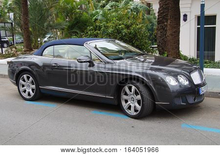 Andalusia, Spain - December 31, 2016: Bentley Continental GT V8 S Convertible parked on a public parking spot. Nobody in the vehicle.