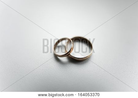 newlyweds with rings on white background wedding bouquet.