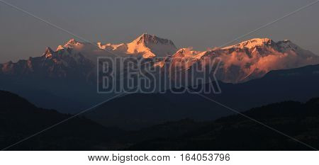 View from Begnas Tal. Peaks of the Annapurna range lit by the last sunlight of the day.