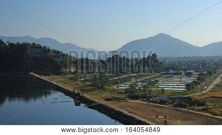 Fish farm near Pokhara Nepal. Dam of lake Begnas Tal.