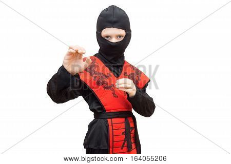 The photo depicts a boy in a ninja suit
