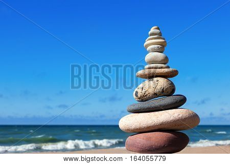 Concept of balance and harmony. stones balance on the background of the sea