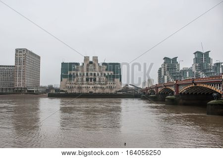 London, UK - 19 december 2016: Building of Secret Intelligence Service MI6 in London, in a grey foggy day