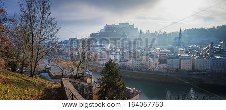 medieval old town of salzburg city on a misty day view to fortress hohensalzburg austria