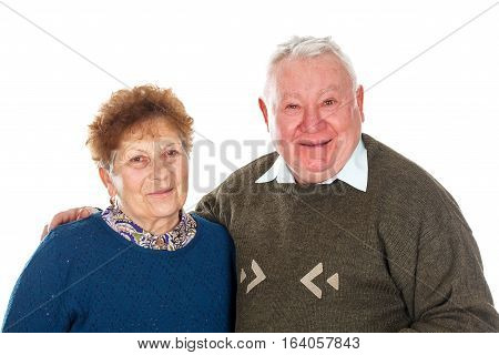 Portrait of an old couple posing on an isolated background