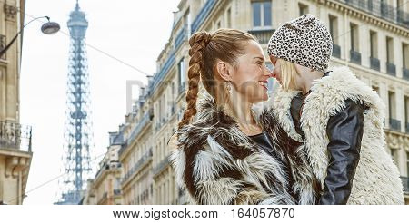 Mother And Daughter In Paris, France Looking At Each Other