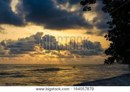 Dramatic sunset over Atlantic ocean with cloudy sky at Limbe, Cameroon, Africa.