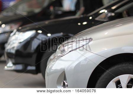 Car headlamp. Part of car at dealership salon