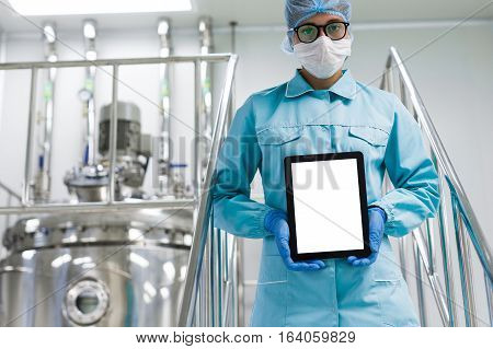 Engineer In The Production Of A Tablet In Hands