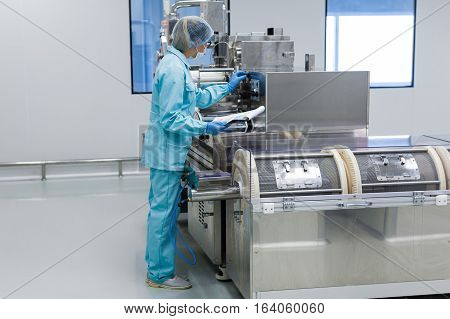 The Operator Monitors The Operation Parameters Of The Machine