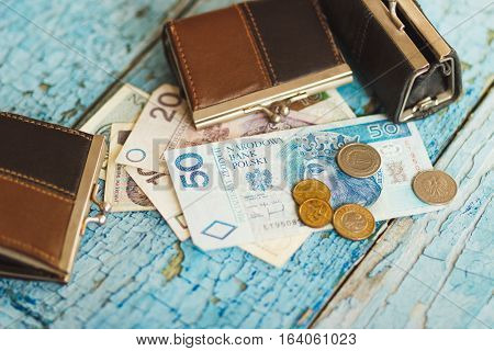 Polish Zloty With Wallets On The Wooden Background