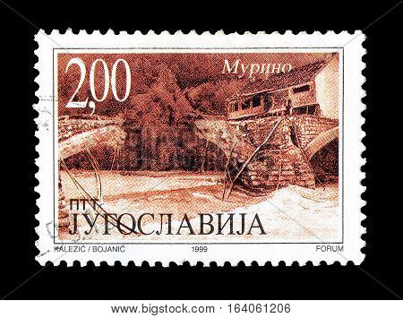 YUGOSLAVIA - CIRCA 1999 : Cancelled postage stamp printed by Yugoslavia, that shows Bombarding of Murino bridge.