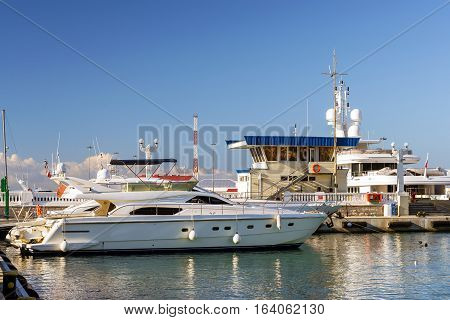 Private boat and yachts moored at pier in Sochi seaport. Marine station complex Port. Krasnodarskiy kray Russia