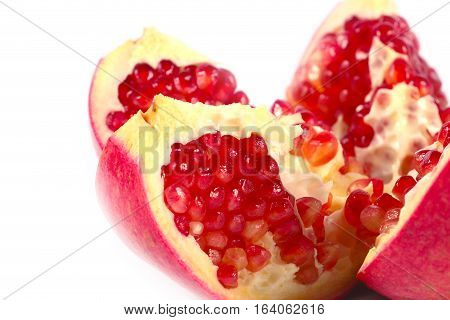 pieces of fresh ripe tropical fruit pomegranate as an element of wholesome food