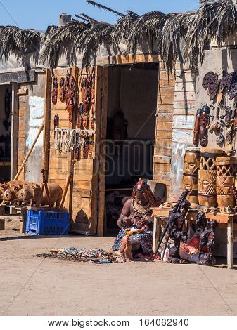 WALVIS BAY NAMIBIA - JUNE 22 2016: Himba woman sells souvenirs in Walvis Bay Namibia.